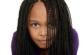 Young black child with braids over face — Stock Photo