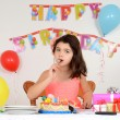 Child eating birthday cake — Stock Photo
