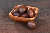 Chestnuts in a wood bowl — Stock Photo