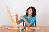 Young child working on painting — Stock Photo