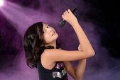 Young girl child singing on stage — Stock Photo