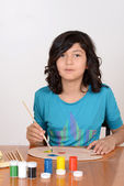 Young girl mixing art paints — Stock Photo