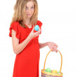 Child holding easter egg and basket — Stock Photo