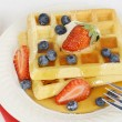 Top view blueberry strawberry syrup waffles — Stock Photo
