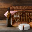 Vintage picnic basket with wine - Stock Photo