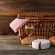 Old picnic basket with wine and cheese — Stock Photo #21463095