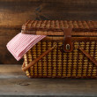 Royalty-Free Stock Photo: Picnic basket on wood