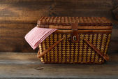 Picnic basket on wood — Stock Photo
