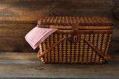 Picnic basket on wood — Stock Photo