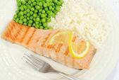 Top view salmon with lemon — Stock Photo