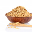 Bowl of granola with wood spoon — Stock Photo