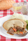 Beef pie with a fork — Stock Photo