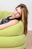 Portrait teen relaxing in chair — Stock Photo
