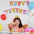 Happy child cutting birthday cake — Stock Photo