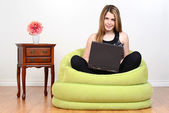Female teen with laptop computer — Stock Photo