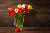 Tulips in vase with texture added — Stock Photo