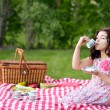 Little girl picnic drinking tea — Stock Photo