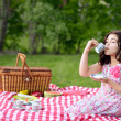 Little girl picnic drinking tea — Stock Photo #26952869