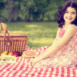 Vintage little girl having a picnic — Stock Photo