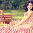Vintage little girl having a picnic — Stok fotoğraf