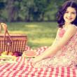 Vintage little girl having a picnic — Stock Photo