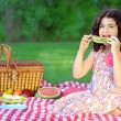 Child with slice watermelon at picnic — Stock Photo