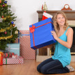 Blonde woman with blue christmas present — Stock Photo