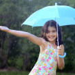 Young girl enjoying the rain — 图库照片
