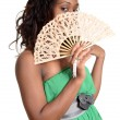 Black woman with fan — Stock Photo
