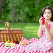 Girl at picnic using red napkin — Stok fotoğraf