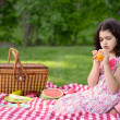 Child peeling orange at picnic — ストック写真