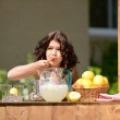 Little girl making lemonade — Stock Photo