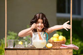 Little girl trying to sell lemonade — Stock Photo
