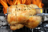 Rotisserie chicken on the grill — Stock Photo