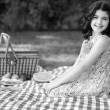 图库照片: Black and white little girl vintage picnic