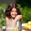 Happy girl at lemonade stand — Stock Photo