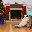 Senior woman reading book in christmas living room — Stock Photo