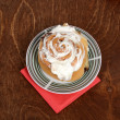 Top view cinnamon bun on a plate — Stock Photo