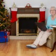 Happy senior with laptop at christmas — Stockfoto
