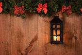 Christmas lantern with pine boughs and bows — Stock Photo
