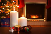 Two christmas candles focus on flame shallow DOF — Stock Photo