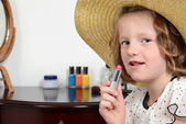 Closeup little girl with lipstick — Stock Photo