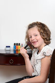 Happy little girl with blush brush — Stock Photo