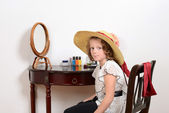 Little girl playing dress up — Stock Photo