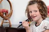 Portrait little girl with blush brush — Stock Photo