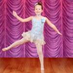 Child jumping ballerina dancer on stage — Stock Photo #38615623