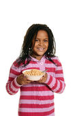 Black girl hold bowl of cereal — Stock Photo