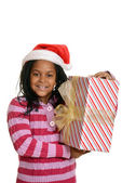 Happy jamaican child with christmas present — Stock Photo