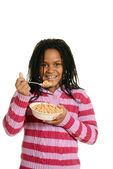 Little black girl enjoying bowl of cereal — Stock Photo