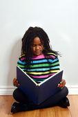Little black girl reading book — Stock Photo